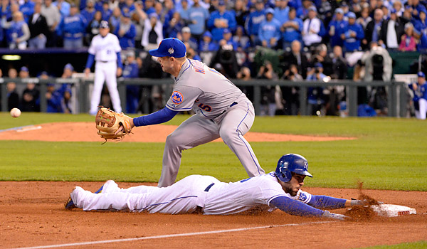 Eric Hosmer slides safely into third base in the fourth inning during Game Two of the 2015 World Series at Kaufmann Stadium in Kansas City, MO. (Photo by Ron Vesely/MLB Photos)