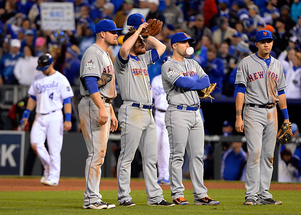 The Mets infield look on during a pitching change during the eighth inning during Game Two of the 2015 World Series at Kaufmann Stadium in Kansas City, MO. (Photo by Ron Vesely/MLB Photos)