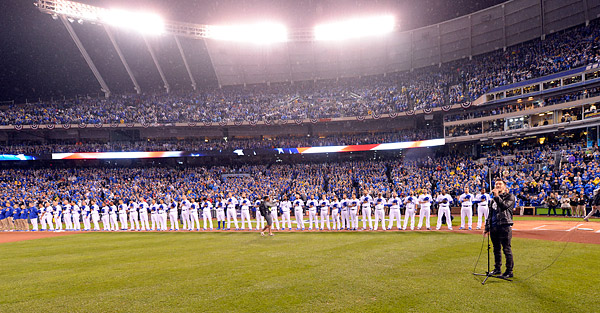 The Royals line up during pre game ceremonies during the National Anthem prior to Game One of the 2015 World Series. (Photo by Ron Vesely/MLB Photos)