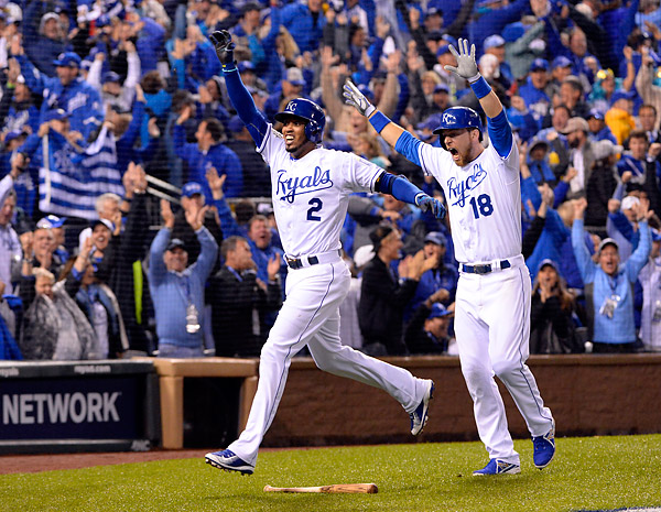Alceides Escobar celebrates after hitting an inside-the-park home run in the first inning off of Matt Harvey during Game One of the 2015 World Series. (Photo by Ron Vesely/MLB Photos)
