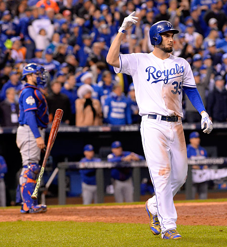 Eric Hosmer flips his bat after hitting a walk-off sacrifice fly in the fourteenth inning of Game One of the 2015 World Series. (Photo by Ron Vesely/MLB Photos)