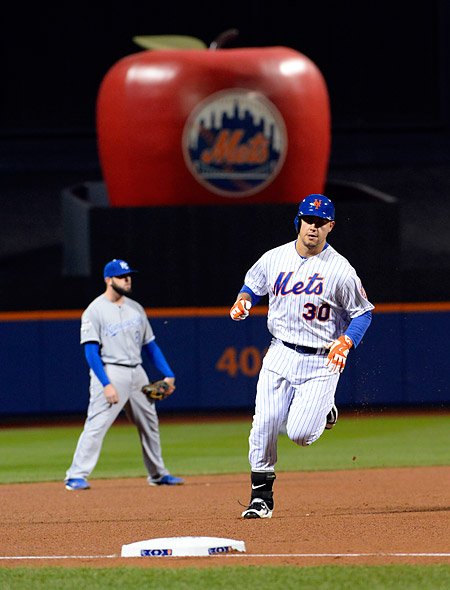 "The ""Big Apple"" does it's thing as Michael Conforto rounds the bases after hitting his second home run of the night during Game Four of the 2015 World Series. (Photo by Ron Vesely/MLB Photos)"