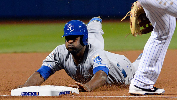 Lorenzo Cain slides safely into third base during the eighth inning of Game Four of the 2015 World Series. (Photo by Ron Vesely/MLB Photos)