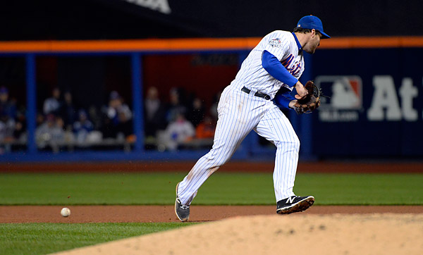 Daniel Murphy boots Eric Hosmer's ground ball in the eighth inning of Game Four of the 2015 World Series. (Photo by Ron Vesely/MLB Photos)