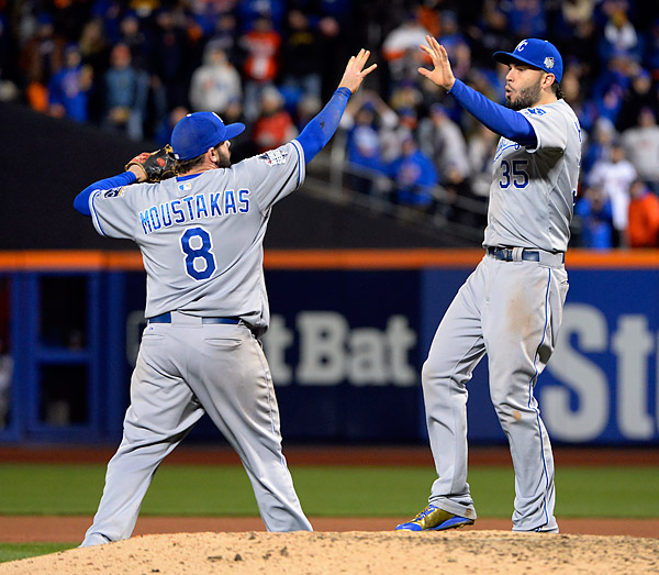 Mike Moustakas and Eric Hosmer celebrate winning Game Four of the 2015 World Series.(Photo by Ron Vesely/MLB Photos)