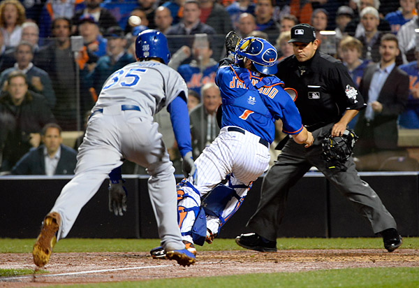 The Kansas City Royals Eric Hosmer scores the tying run in the bottom of the ninth inning after Lucas Duda of the New York Mets threw the ball wildly past Mets catcher Travis d'Arnaud during Game Five of the 2015 World Series. (Photo by Ron Vesely/MLB Photos)