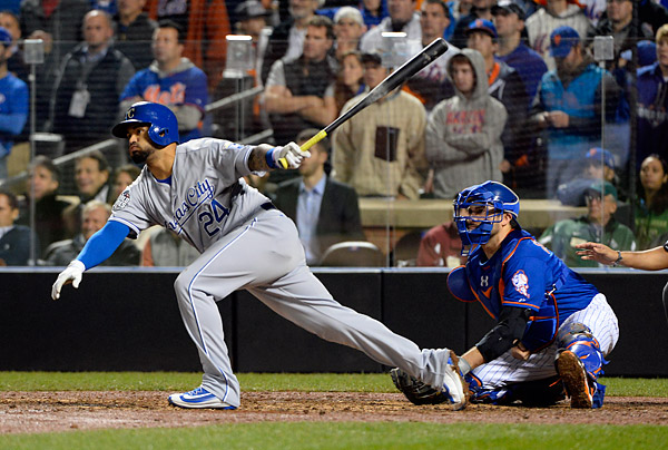 An unlikely hero, Christian Colon, delivers a clutch, one out single to score Jarrod Dyson with the World Series winning run during Game Five of the 2015 World Series. (Photo by Ron Vesely/MLB Photos)