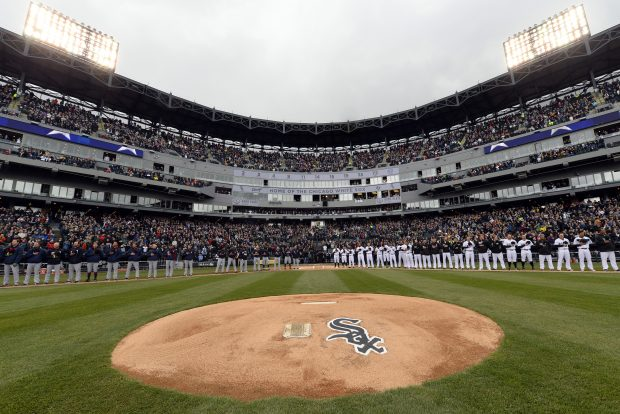 The Cleveland Indians and Chicago White Sox line up for the National Anthem during Opening Day festivities at U.S. Cellular Field on April 8, 2016. (Photo by Ron Vesely)