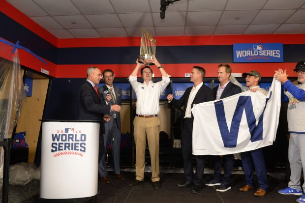 CLEVELAND, OH - NOVEMBER 2: Chicago Cubs Chairman and Owner Tom Ricketts holds the World Series trophy after Game 7 of the 2016 World Series against the Cleveland Indians at Progressive Field on Wednesday, November 2, 2016 in Cleveland, Ohio. (Photo by Ron Vesely/MLB Photos via Getty Images)