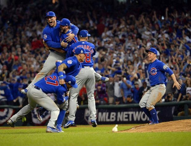 CLEVELAND, OH - NOVEMBER 2: Anthony Rizzo, Kris Bryant, Addison Russell and Javier Baez celebrate after the final out of Game 7 of the 2016 World Series against the Cleveland Indians at Progressive Field on Wednesday, November 2, 2016 in Cleveland, Ohio. (Photo by Ron Vesely/MLB Photos via Getty Images)