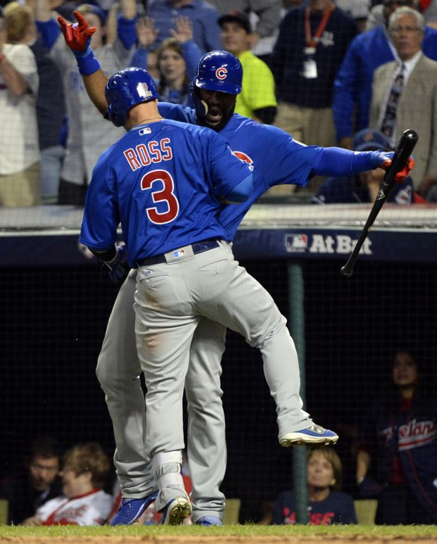 CLEVELAND, OH - NOVEMBER 2: David Ross #3 celebrates with Jason Heyward #22 of the Chicago Cubs after hitting a solo home run in the sixth inning of Game 7 of the 2016 World Series against the Cleveland Indians at Progressive Field on Wednesday, November 2, 2016 in Cleveland, Ohio. (Photo by Ron Vesely/MLB Photos via Getty Images)