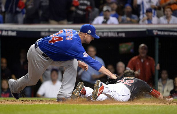 CLEVELAND, OH - NOVEMBER 2: Jason Kipnis #22 of the Cleveland Indians scores on a wild pitch ahead of the tag by Jon Lester #34 of the Chicago Cubs in the fifth inning during Game 7 of the 2016 World Series against the Cleveland Indians at Progressive Field on Wednesday, November 2, 2016 in Cleveland, Ohio. (Photo by Ron Vesely/MLB Photos via Getty Images)