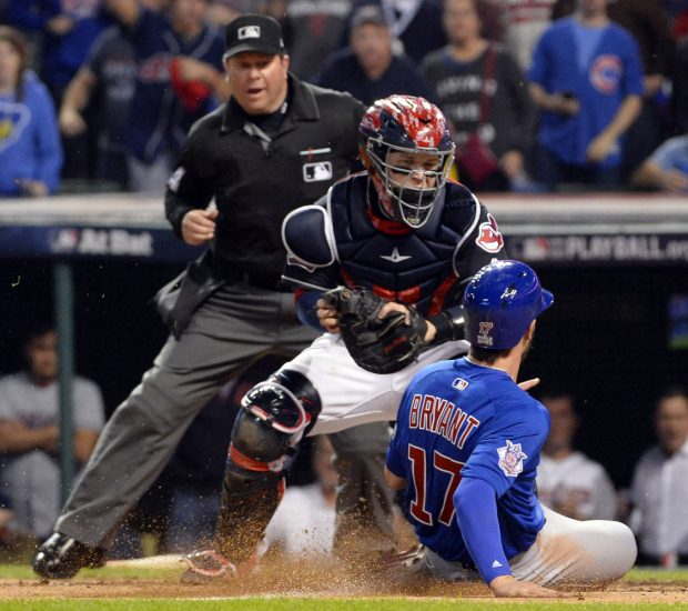 CLEVELAND, OH - NOVEMBER 2: Kris Bryant #17 of the Chicago Cubs scores a run on a Addison Russell #27 sacrifice fly in the fourth inning during Game 7 of the 2016 World Series against the Cleveland Indians at Progressive Field on Wednesday, November 2, 2016 in Cleveland, Ohio. (Photo by Ron Vesely/MLB Photos via Getty Images)