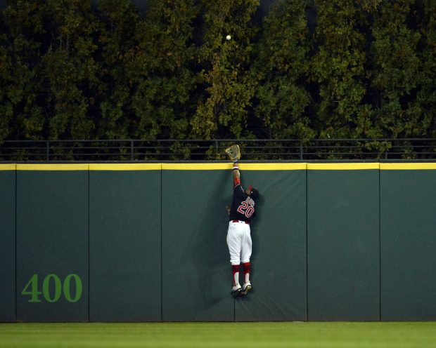 CLEVELAND, OH - NOVEMBER 2: Rajai Davis #20 of the Cleveland Indians tries to make the catch as the ball hit by Dexter Fowler #24 of the Chicago Cubs goes over the wall for a solo home run in the first inning of Game 7 of the 2016 World Series at Progressive Field on Wednesday, November 2, 2016 in Cleveland, Ohio. (Photo by Ron Vesely/MLB Photos via Getty Images)