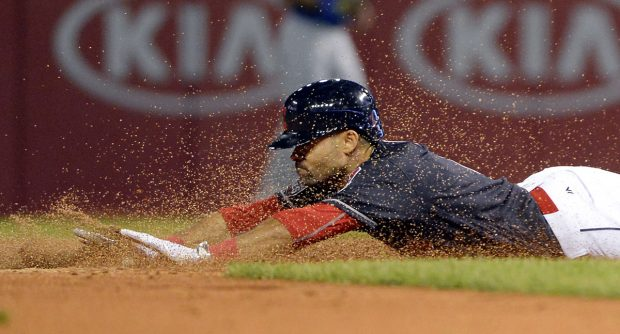 CLEVELAND, OH - NOVEMBER 2: Coco Crisp #4 of the Cleveland Indians slides into second after doubling in the bottom of the third inning of Game 7 of the 2016 World Series against the Chicago Cubs at Progressive Field on Wednesday, November 2, 2016 in Cleveland, Ohio. (Photo by Ron Vesely/MLB Photos via Getty Images)
