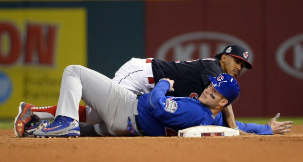 CLEVELAND, OH - NOVEMBER 2: Francisco Lindor #12 of the Cleveland Indians forces out Anthony Rizzo #44 of the Chicago Cubs at second base in the fourth inning during Game 7 of the 2016 World Series at Progressive Field on Wednesday, November 2, 2016 in Cleveland, Ohio. (Photo by Ron Vesely/MLB Photos via Getty Images)