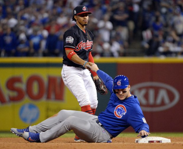 CLEVELAND, OH - NOVEMBER 2: Francisco Lindor #12 of the Cleveland Indians helps Anthony Rizzo #44 of the Chicago Cubs to his feet after a force out at second base in the fourth inning during Game 7 of the 2016 World Series at Progressive Field on Wednesday, November 2, 2016 in Cleveland, Ohio. (Photo by Ron Vesely/MLB Photos via Getty Images)