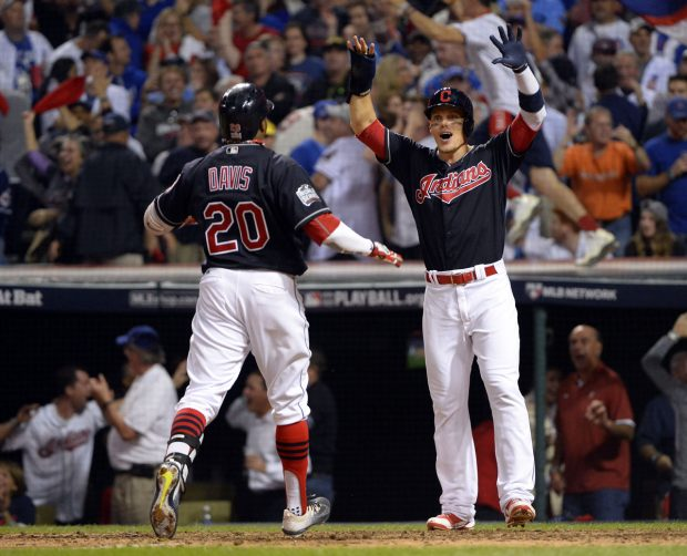 CLEVELAND, OH - NOVEMBER 2: Rajai Davis #20 of the Cleveland Indians is greeted at home plate by teammate Brandon Guyer #6 after hitting a two-run home run in the eighth inning during Game 7 of the 2016 World Series against the Chicago Cubs at Progressive Field on Wednesday, November 2, 2016 in Cleveland, Ohio. (Photo by Ron Vesely/MLB Photos via Getty Images)